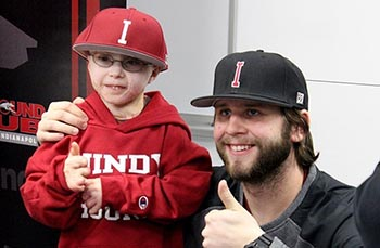 Young Owen Mahan poses with UIndy teammate Evan Eyer in February after signing with the Greyhounds.