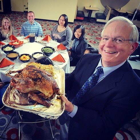 Ted Polk serves up Thanksgiving turkey, a UIndy tradition.