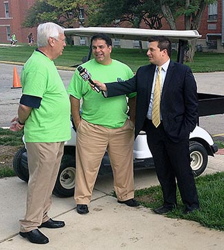 Board of Trustees Chair Tom Martin and UIndy President Rob Manuel talk with WXIN's   MIchael Henrich.