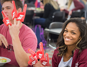 Students sport foam fingers during the lunchtime pep rally.