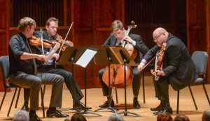 Debut performance of the faculty artist series String Quartet in the Ruth Lilly Performance Hall on November 7, 2016. Quartet is composed of Zachary DePue, violin; Austin Hrtman, violin; Austin Huntington, cello; and Michael Strauss, viola. (Photo by D. Todd Moore, University of Indianapolis)