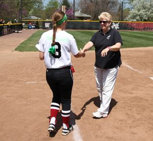 Sue Willey, right, greets an athlete