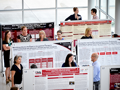 "UIndy students show research posters in the atrium of the Health Pavilion as part of the first annual Health Pavilion Scholarship Day hosted by the Health Science Colleges on Friday, May 19, 2017. The event was followed by the Second Annual Multidisciplinary Scholarly Activity Symposium held by Community Health Network with UIndy partnership support. Chad Priest, RN, JD, Chief Executive Officer of he American Red Cross of Indiana Region, is the speaker delivering a keynote on ""The Healthcare Professionals of the Future"" in Schwitzer following the luncheon. (Photo: D. Todd Moore, University of Indianapolis)"