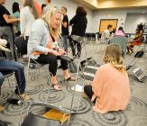 Public Health students, in conjunction with the physical therapy program, participate in a Poverty Simulation on May 23, 2017. (Photo: D. Todd Moore, University of Indianapolis)