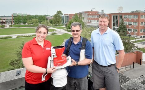 From left: Carly Nicholson '17, Dr. Tim Duman and Luke Hunnewell of WeatherSTEM.