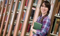 Lauren Judd, UIndy undergraduate and master's degree holder, is headed to Stanford to pursue her PhD in History. She poses for photos in the Krannert Memorial Library on Wednesday, May 24, 2017. (Photo: D. Todd Moore, University of Indianapolis)