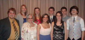 Audrey Cunningham, front row, second from left, with the Speech & Debate Team in 2011.