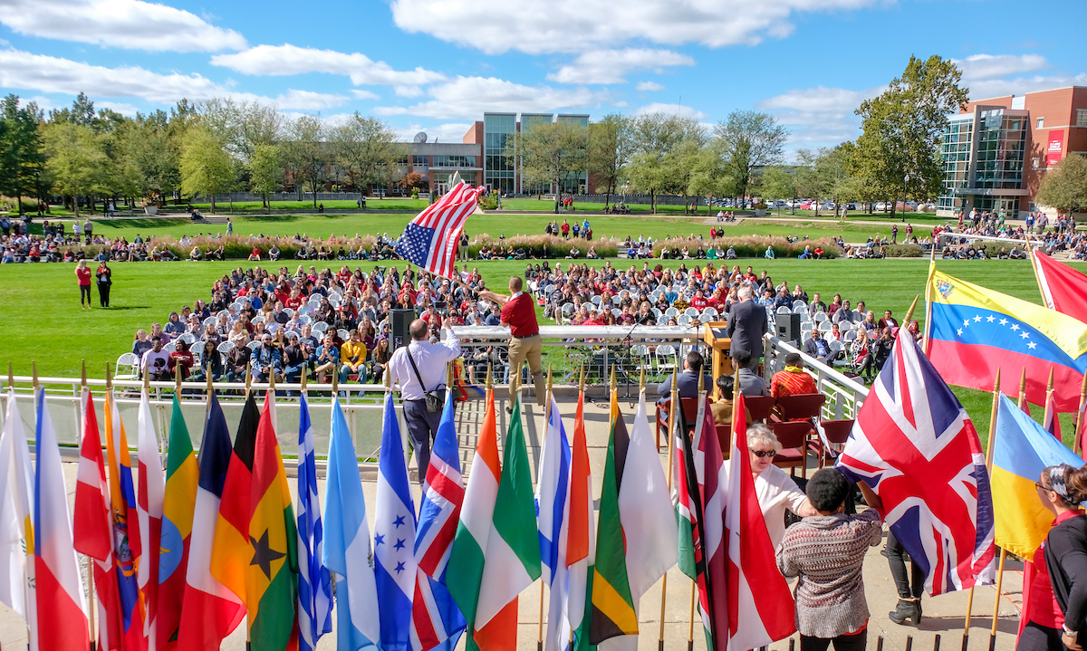 30th annual Celebration of the Flags was held on Smith Mall on Thursday, October 11, 2018. Modeled after the Olympic-style opening ceremony, flag bearers feature the national colors and dress of their country. Speakers include President Robert L. Manuel, Indianapolis Student Government President Jamarcus Walker and Craig Anesu Chigadza, an international student from Zimbabwe. Performers include Adam Fernandes '22 (graphic design) on guitar and Caroline Kavanaugh '22 (exercise science) on violin. (Photo: D. Todd Moore, University of Indianapolis)