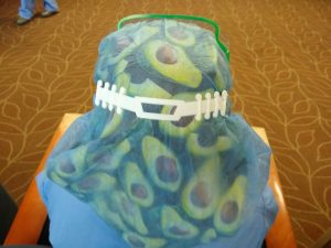 "A nurse at an Indianapolis-area hospital wears one of the ""ear-savers"" produced by Paul Talaga."