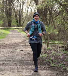 Laura running during 40-mile race April 2019