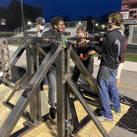 Setting up the trebuchet at Key Stadium