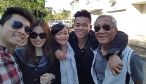 John Phan, second from right, with his family in Vietnam.